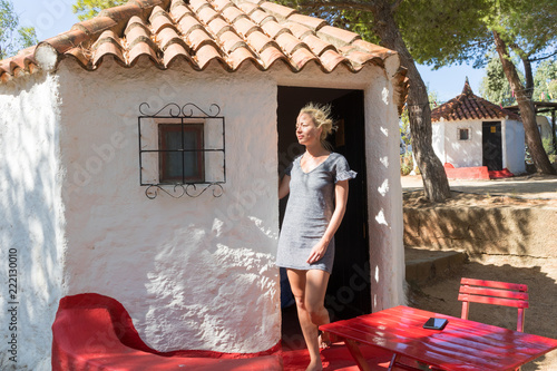 Woman enjoying refreshing and relaxing summer vacations in authentic vintage bungalow of camping village under mediterranean pine trees, Palau, Sardinia, Italy Wallpaper Mural