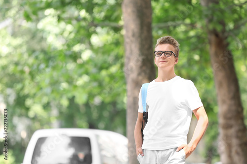 Fotografiet  Teenage boy with backpack outdoors