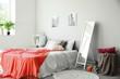 Interior of beautiful bedroom with big mirror
