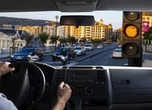 Inside Car View Of A Orange Traffic Light