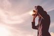 Leinwandbild Motiv Asian man Hand Holding Binoculars / looking / watching using Binoculars with copyspace,Concept of The pursuit of profitable business in the future.