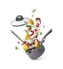 Composition With Saucepans And Pasta With Vegetables Flying In The Air Isolated On White Background