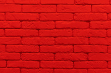 Red Brick Wall Painted At Saturated Scarlet Colour.