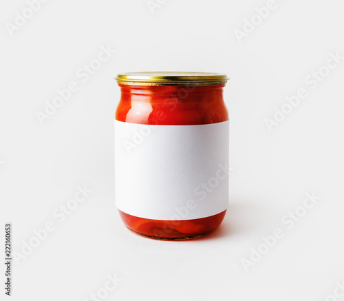 Red paprika canned in a jar with blank label. Pickled vegetables. Responsive design mockup.