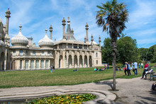 People Enjoying The Gardens Of The Royal Pavilion In Brighton, Sussex, UK