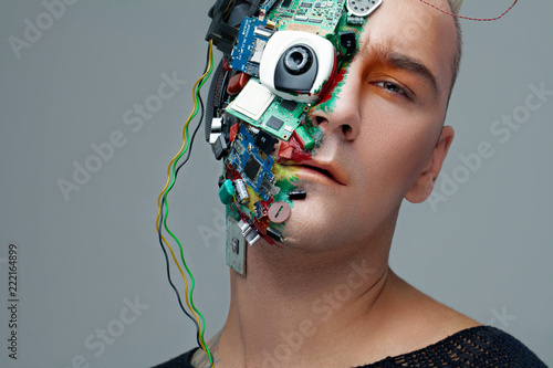 Photo Studio photo of man cyborg, half face computer elements and with professional make-up, white Iroquois on head