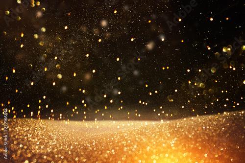 Fotografía  glitter vintage lights background. black and gold. de-focused.