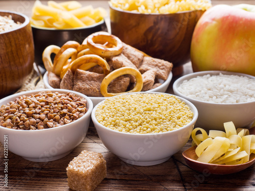 Fotografía  Foods high in carbohydrate on rustic wooden background.