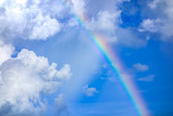 Fototapeta Tęcza - real rainbow on blue sky with clouds nature background.