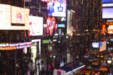 Neon Heart Seen Through Rain Drops And Wet Window And Background Bokeh Of Traffic And Billboards In Times Square, New York City