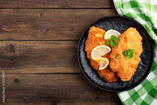 Fototapeta Homemade breaded german weiner schnitzel with potatoes. top view obraz