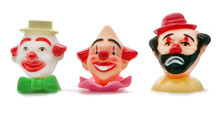 Colorful Plastic Birthday Cake Clown Head Decorations. Isolated.
