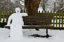Close Up Of A Snowman Sitting ...