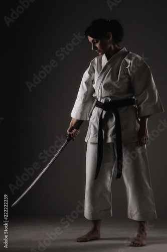 Photo sur Toile Combat karate girl holding a sword