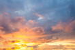 view of a warm orange sunset with clouds in pastel colors
