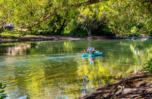 Two Kayakers Enjoy The Quiet S...