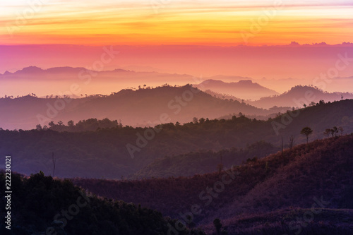 In de dag Ochtendgloren Colorful landscape view in early morning before the sunrise with misty covered mountain hills at Thong Pha Phum. Kanchanaburi, Thailand