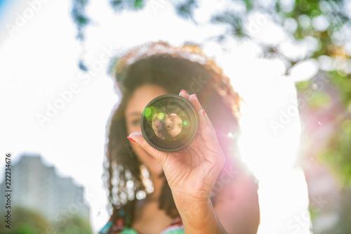 Fotografie, Obraz  Black woman holding a camera len