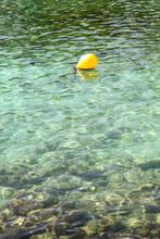 Yellow Fishing Buoy Floating In Mediterranean Sea