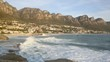 Waves breaking on the scenic coastline at Camps Bay