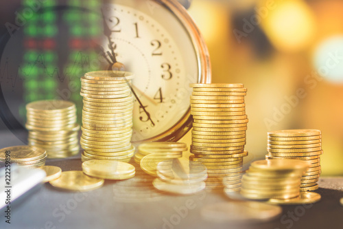 Fototapeta double exposure stack of coins ,clock and stock market screen ,saving,investment concept background   obraz