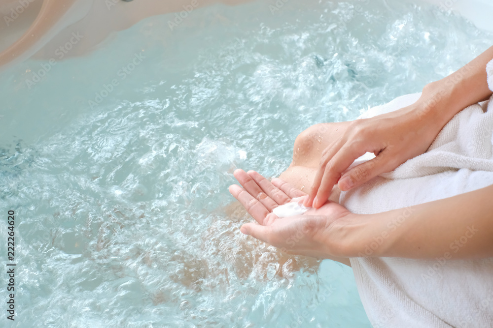 woman holding soap on pool/bathtub with space, can used for design, Top View, beauty concept.