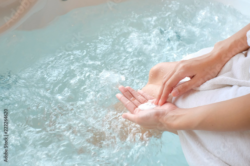 Fototapety, obrazy: woman holding soap on pool/bathtub with space, can used for design, Top View, beauty concept.