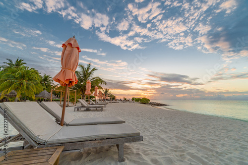 Fotografía  Sunset beach scene, loungers and white sandy beach