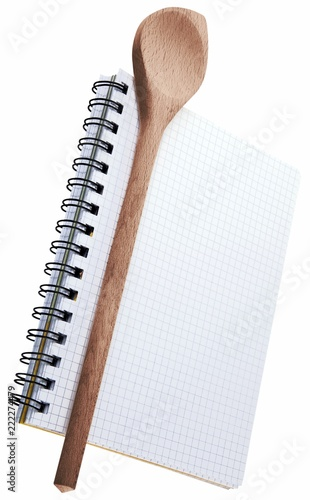 Wooden spoon on top of a notebook