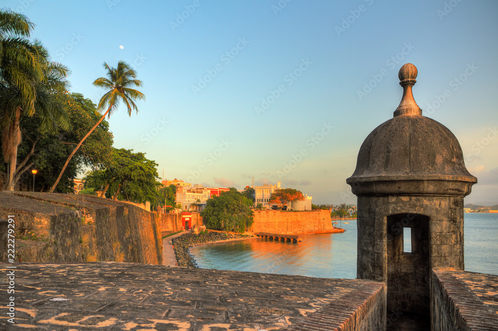 Fototapety, obrazy: Beautiful summer afternoon at the outer wall with sentry box of fort San Felipe del Morro in old San Juan in Puerto Rico