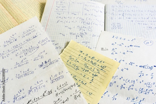 old sheets of paper with mathematical and physical calculations