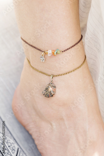 Tiny little jewelry on female ankle Canvas Print