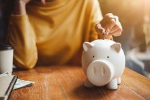 Hand Put Money Coin Into Piggy For Saving Money Wealth