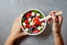 Eating Greek Salad From Take Away Bowl; From Above
