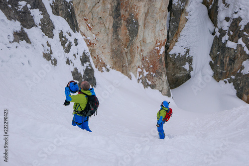 Fotobehang Wintersporten Off-piste skiers are practicing rock climbing.