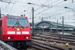 red train depart from the station Cologne Germany.
