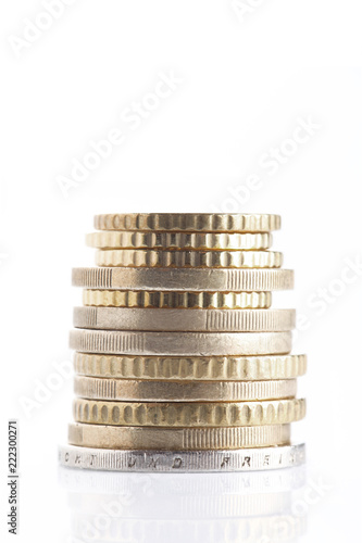 Fotografia  money and finance concept: group of coin pile and isolated on white background w