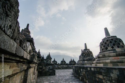 Spoed Foto op Canvas Bedehuis Brahma Vihara Arama in northern Bali is built in the style of the famous Borobudur temple in cloudy day
