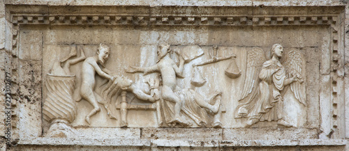 Fotografía Angels and demons on medieval bas-relief, from the facade of Saint Peter church, Spoleto, Italy