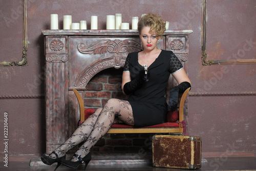 Blonde in black gloves armed with Beretta Wallpaper Mural