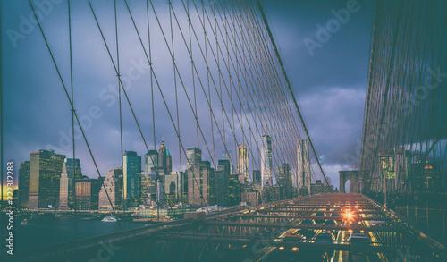 Spoed Foto op Canvas New York City Car traffic on Brooklyn Bridge in New York