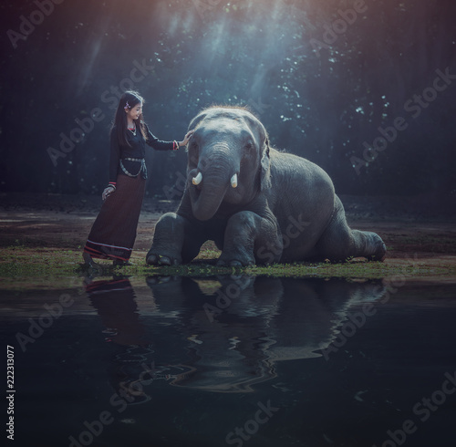 Beautiful Asian Woman wears Thai dress with her elephant, Surin, Countryside of Canvas Print