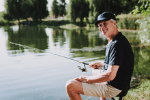 Old Man With Gray Hair Fishing...