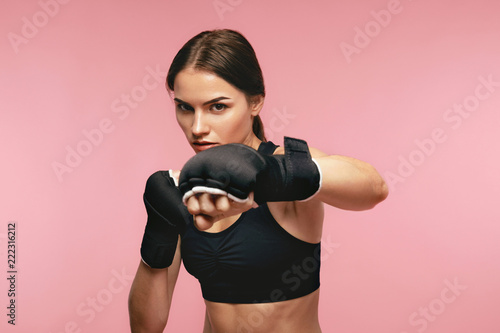 Photographie Female Boxer. Sportswoman Training In Boxing Bandages