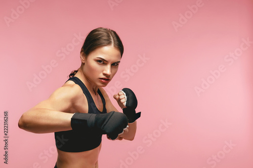 Female Boxer. Sportswoman Training In Boxing Bandages Tableau sur Toile