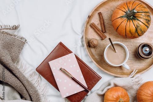 Fotografía  Cozy flatlay with wooden tray, cup of coffee or cocoa, candle, pumpkins, noteboo