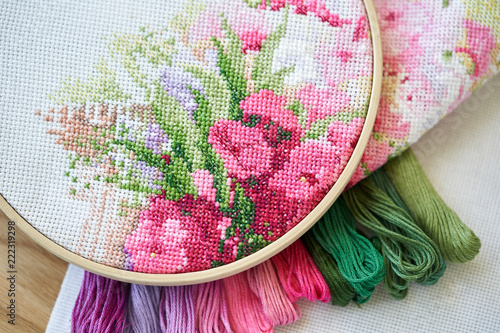 Hoop with aida with a fragment of an embroidery Canvas Print