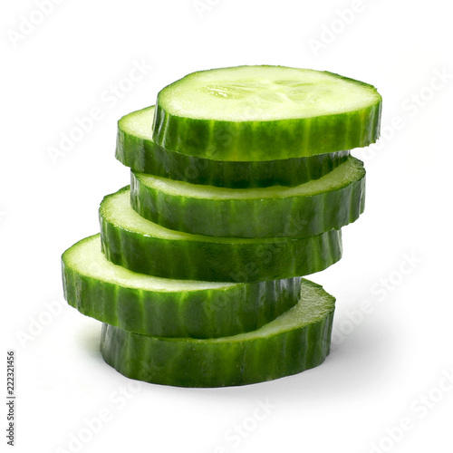 Fresh cucumber slices, isolated on white background. Close up shot of cucumber, arrangement or pile.