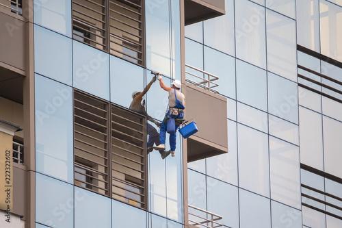 Fotografie, Obraz  Industrial climber wash the windows of modern skyscraper