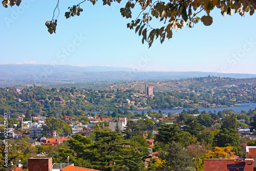 In de dag Rio de Janeiro VILLA CARLOS PAZ, CORDOBA, ARGENTINA - APRIL 11, 2009: Panoramic view from the top of a hill of the landscape of Carlos Paz Town in a sunny day.